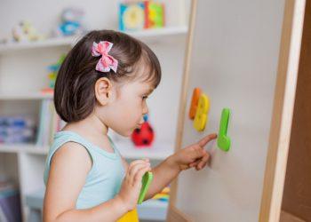 preschool-girl-studying-letters-alphabet_73683-2112